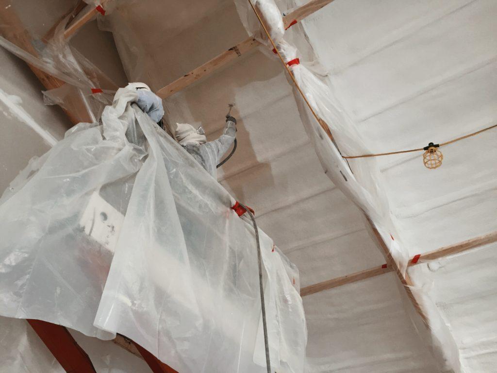 Fireproofing over spray foam insulation